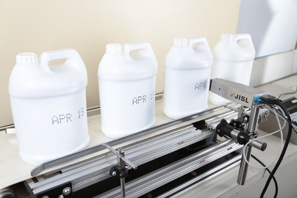 Printing on white cans using industrial printers