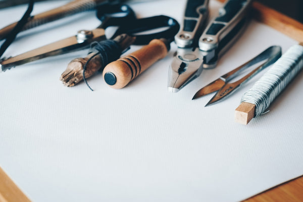 A collection of hand tools like pliers and tweezers