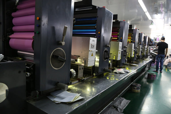 A person walking inside a label printing factory