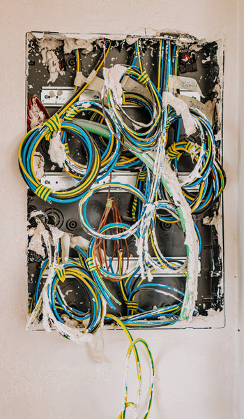 Blue, yellow, and white color coiled wires in a circuit board