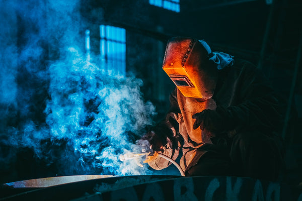 A person wearing essential safety wear working inside an industry