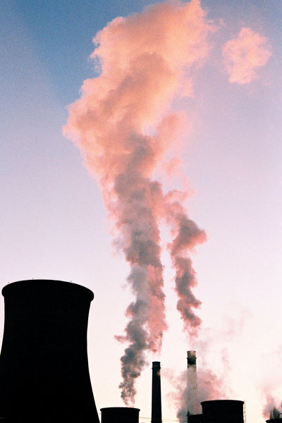 White color fume coming out of a factory chimney