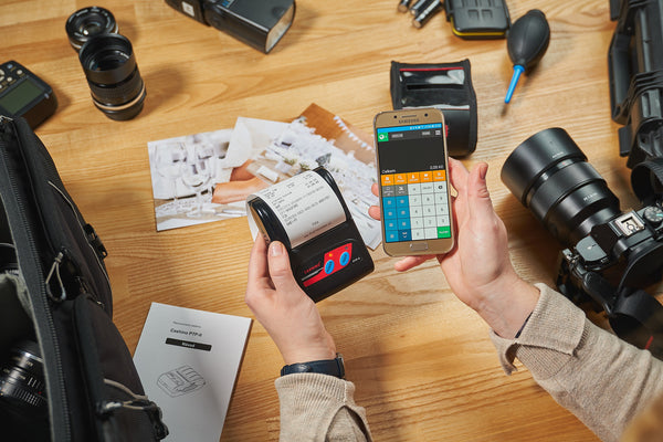 A person using a mobile printer app to generate a wireless connection