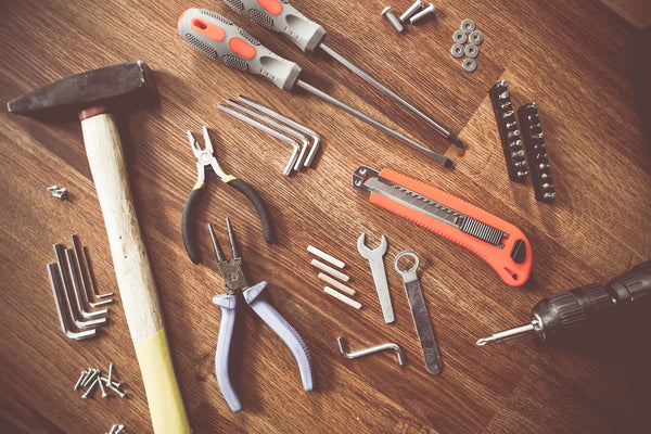 A neatly arranged workbench with essential tools