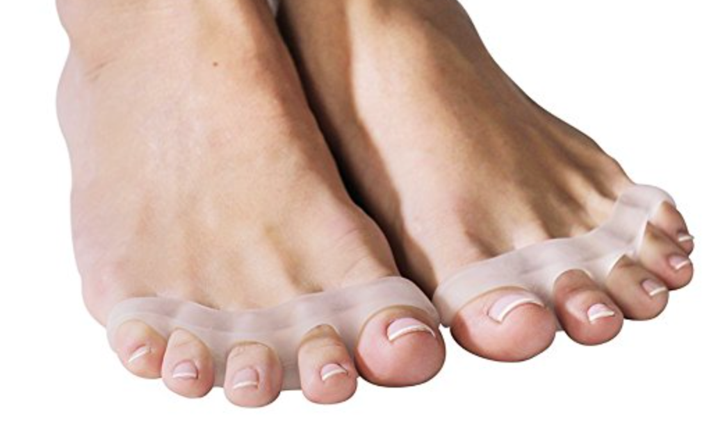 Why wear toe spreaders?