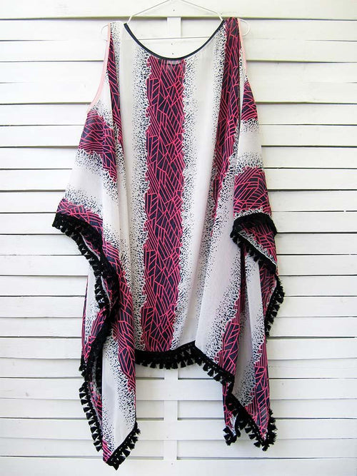 Caftan dress in white color with geometric and abstract pattern and navy blue and neon fuchsia hues and black fringed ribbon