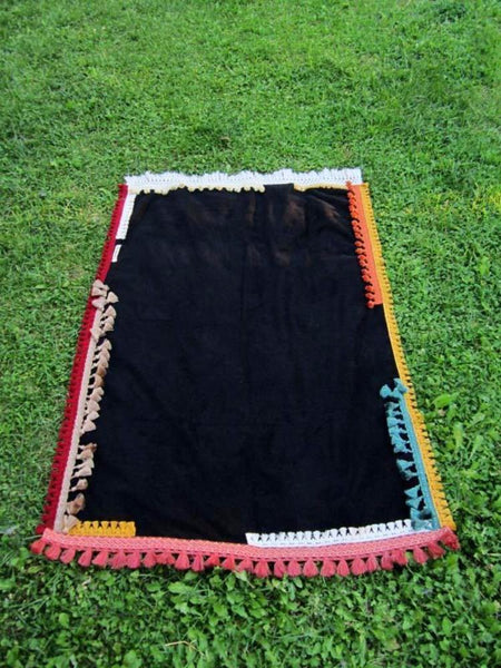 Beach towel in black color with tassels
