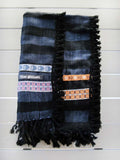 Peshtemal in navy blue color with a combination of different custom designed woven ribbons and cotton tassels