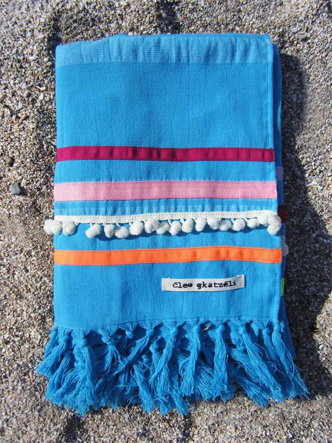 Peshtowel/towel in turquoise color with three different ribbons and a pom pom band