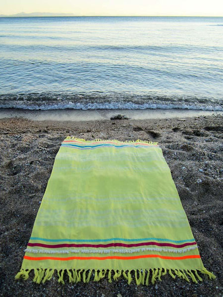 Peshtowel/towel in citron color with three different ribbons and a pom pom band