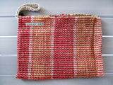 Rug clutch bag in orange color and vertical design