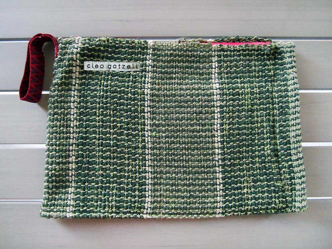 Rug clutch bag in green color and vertical design