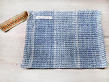Rug clutch bag in ciel color and vertical design