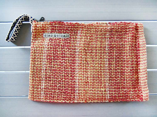 Rug clutch bag in yellow color and vertical design