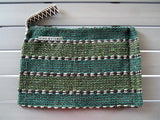 Rug clutch bag in green color and stripes