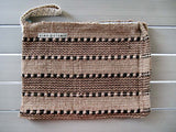 Rug clutch bag in beige color and stripes