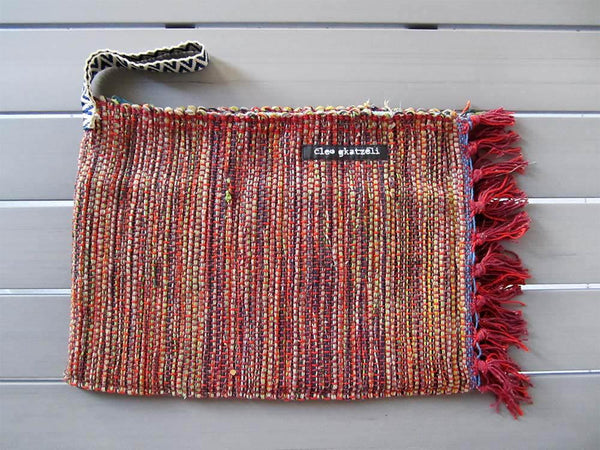 Rug clutch bag in brick color