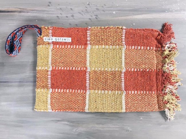 Rug clutch bag in orange color and vichy design