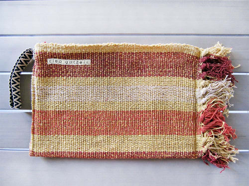 Rug clutch bag in yellow color and wide stripes