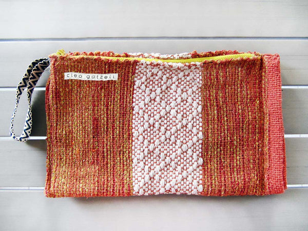 Rug clutch bag in orange and white color