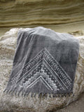 Peshtowel/towel in iron stonewashed color with a grunge plain print in white colour