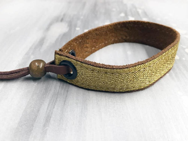 Leather bracelet with a gold foil herringbone tape