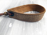 Leather bracelet with a bronze foil herringbone tape