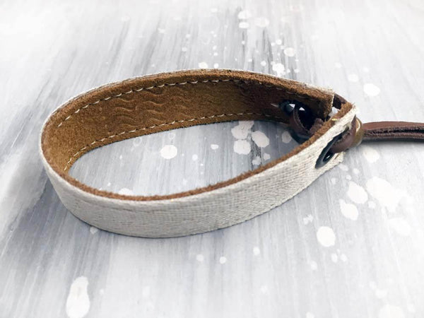 Leather bracelet with a silver foil herringbone tape