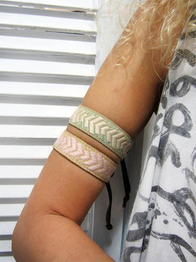 Leather bracelet with a woven ribbon and fishbone pattern