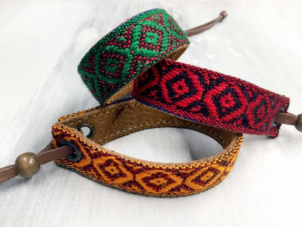 Leather bracelet with a woven ribbon and Aztec pattern
