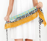 Belt in balck and white color with woven ribbons and cotton fringes