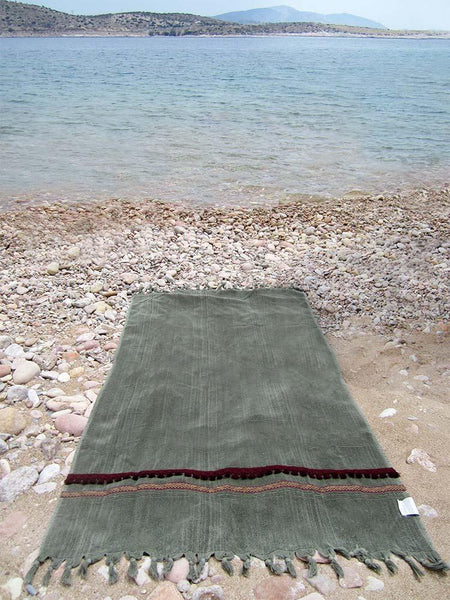 Peshtowel/towel in army stonewashed color with a woven ribbon and a fringed band