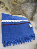 Peshtowel/towel in denim stonewashed color with a woven ribbon and a fringed band