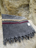 Peshtowel/towel in iron stonewashed color with a woven ribbon and a fringed band