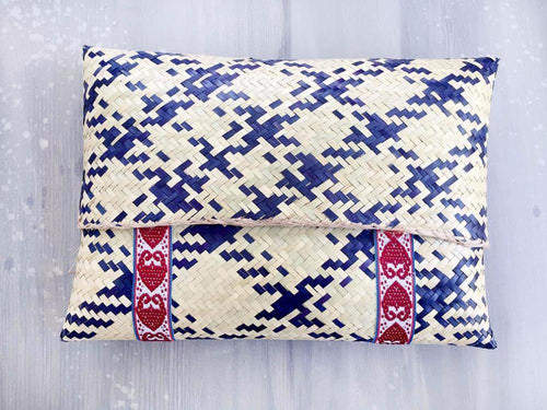 Straw clutch in blue gingham design with a red decorative ribbon