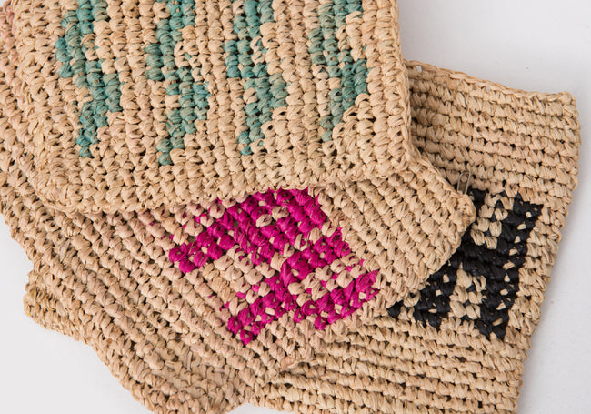 HAPPY woven straw clutch