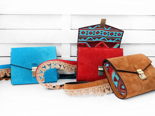 DIONE belt clutch bag