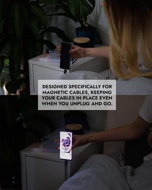 Woman using Chargeasap Magnetic Cable organizer with their Infinity magnetic cable