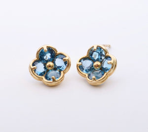 14K yellow gold flower-shaped post earrings with Blue Topaz