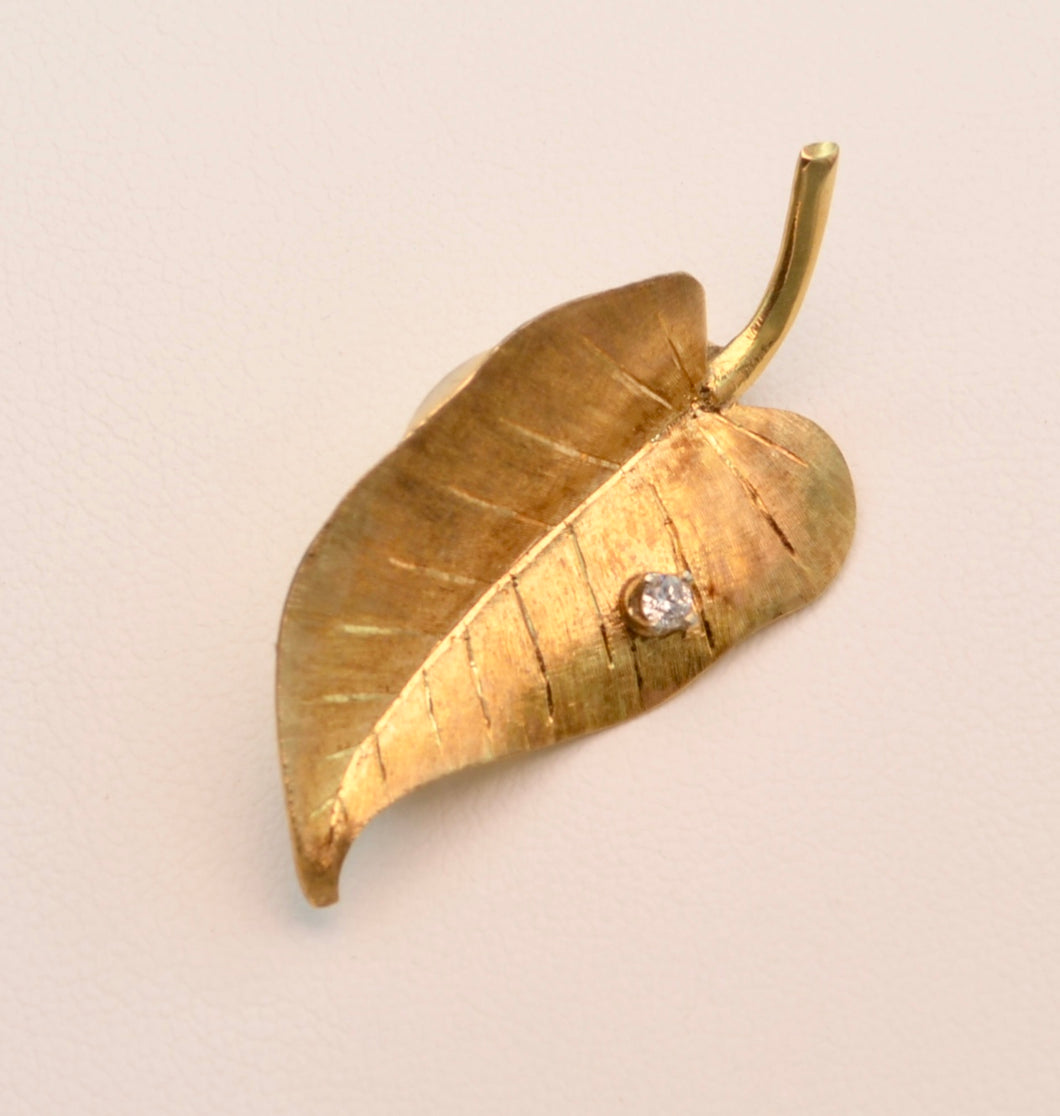 14K yellow gold leaf  pin with one diamond dew drop