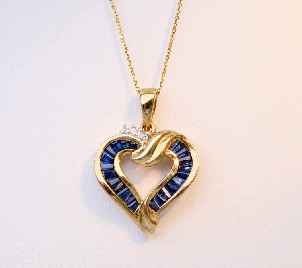 10K yellow gold heart-shaped pendant with Blue Sapphires and small Diamonds for the sparkle