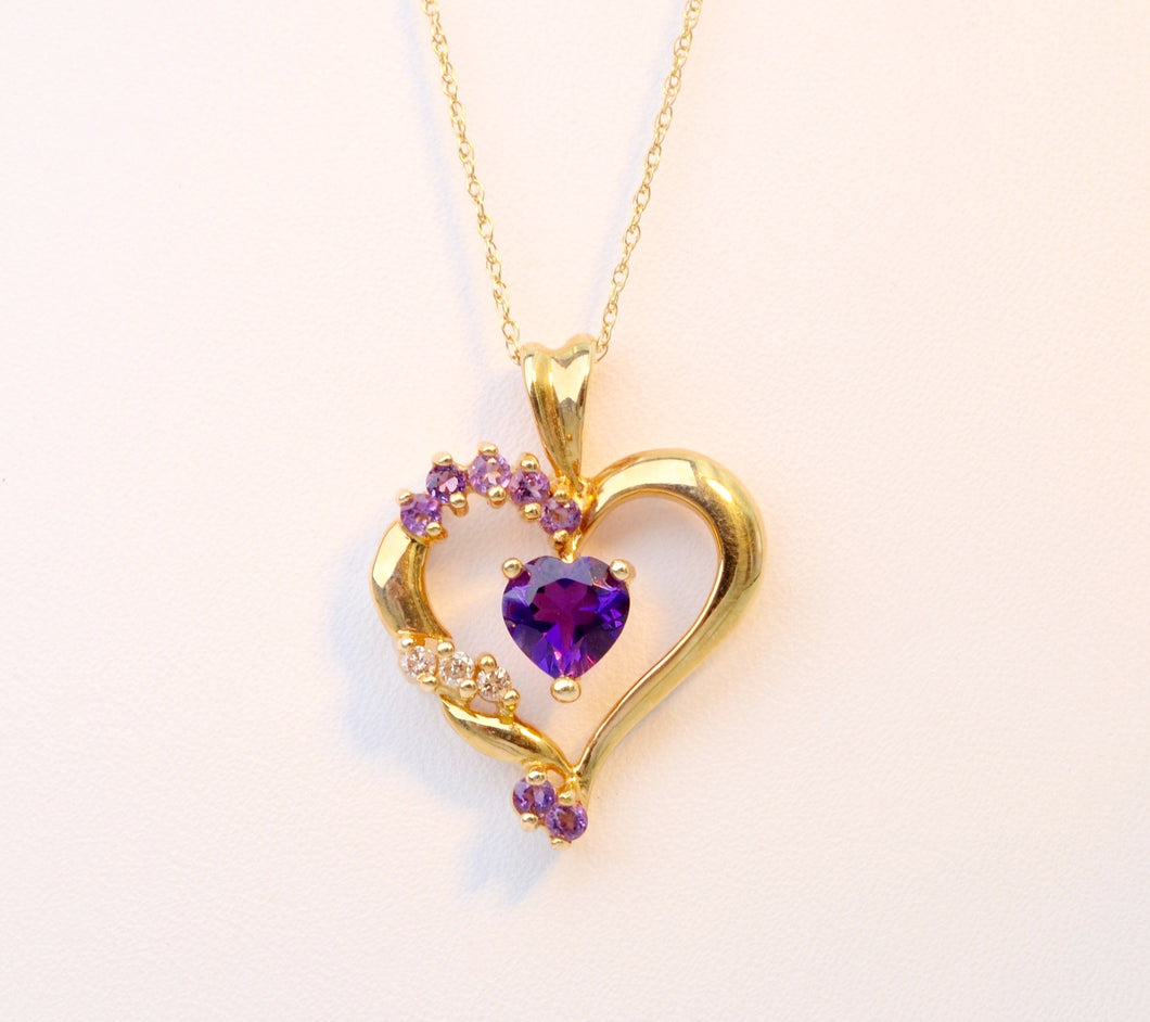 Heart-shaped pendant set with one center Amethyst and 3 side Diamonds