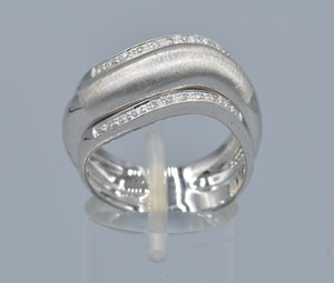 18K white gold ring with one center plain gold and two side diamond rings in one curved design