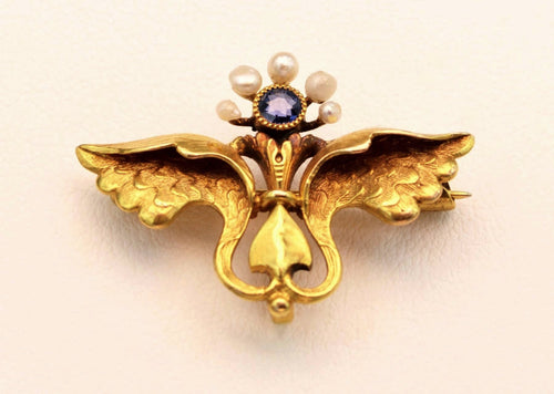 14K yellow gold Mercury-themed brooch with one Sapphire and 5 seed pearls