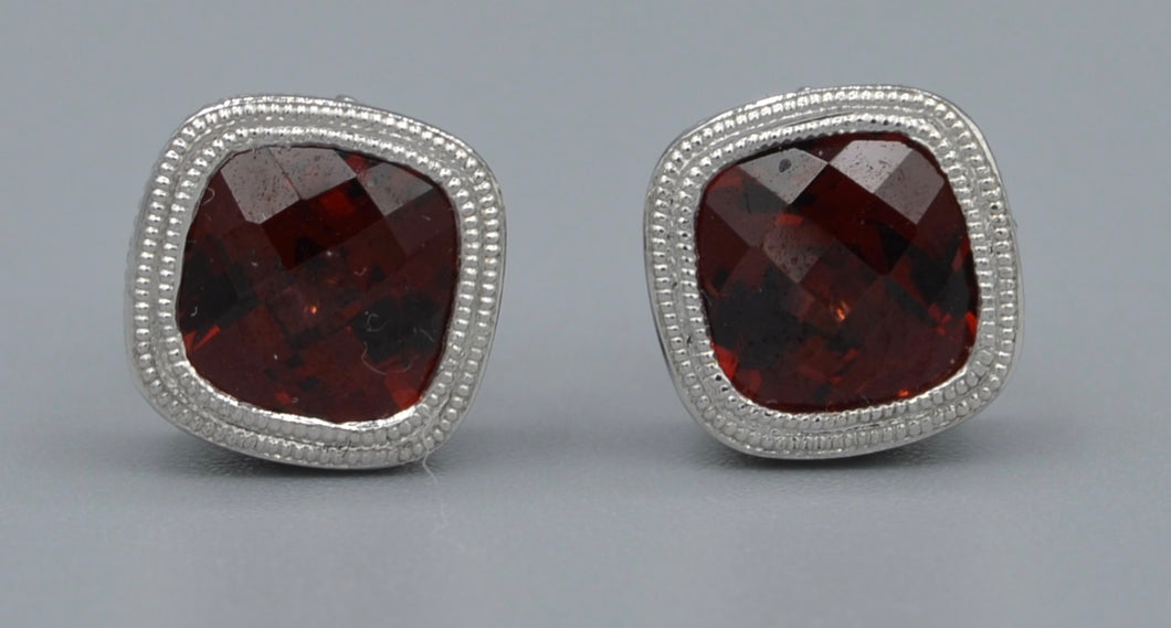 14K white gold post earrings with faceted garnets in square criss-cross cut