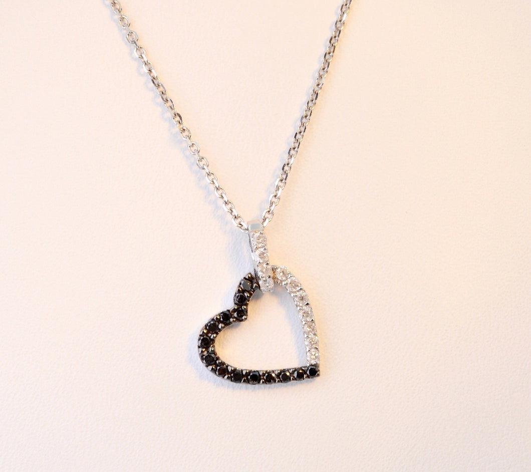 Heart-shaped diamond pendant with 1/2 black and 1/2 white diamonds, 14K white gold