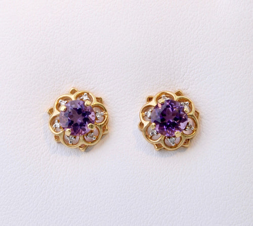 14K yellow gold post earrings with one center Amethyst and six Diamonds