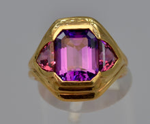 14K yellow gold ring with one center Amethyst and two side Rhodolite Garnets