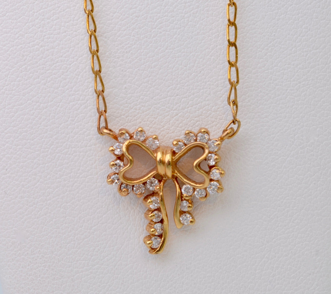 Diamond-studded Bow-Shaped Necklace in 14K Yellow Gold