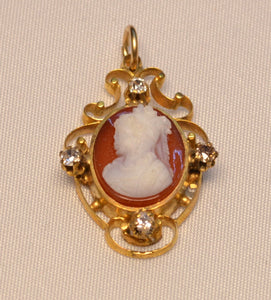 14K yellow gold hard stone cameo pendant with four old cut diamonds